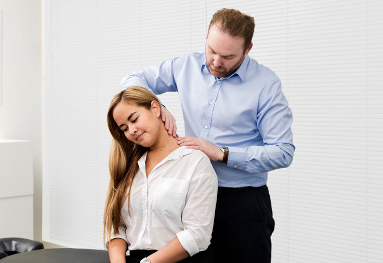 Physiotherapist working on client's neck