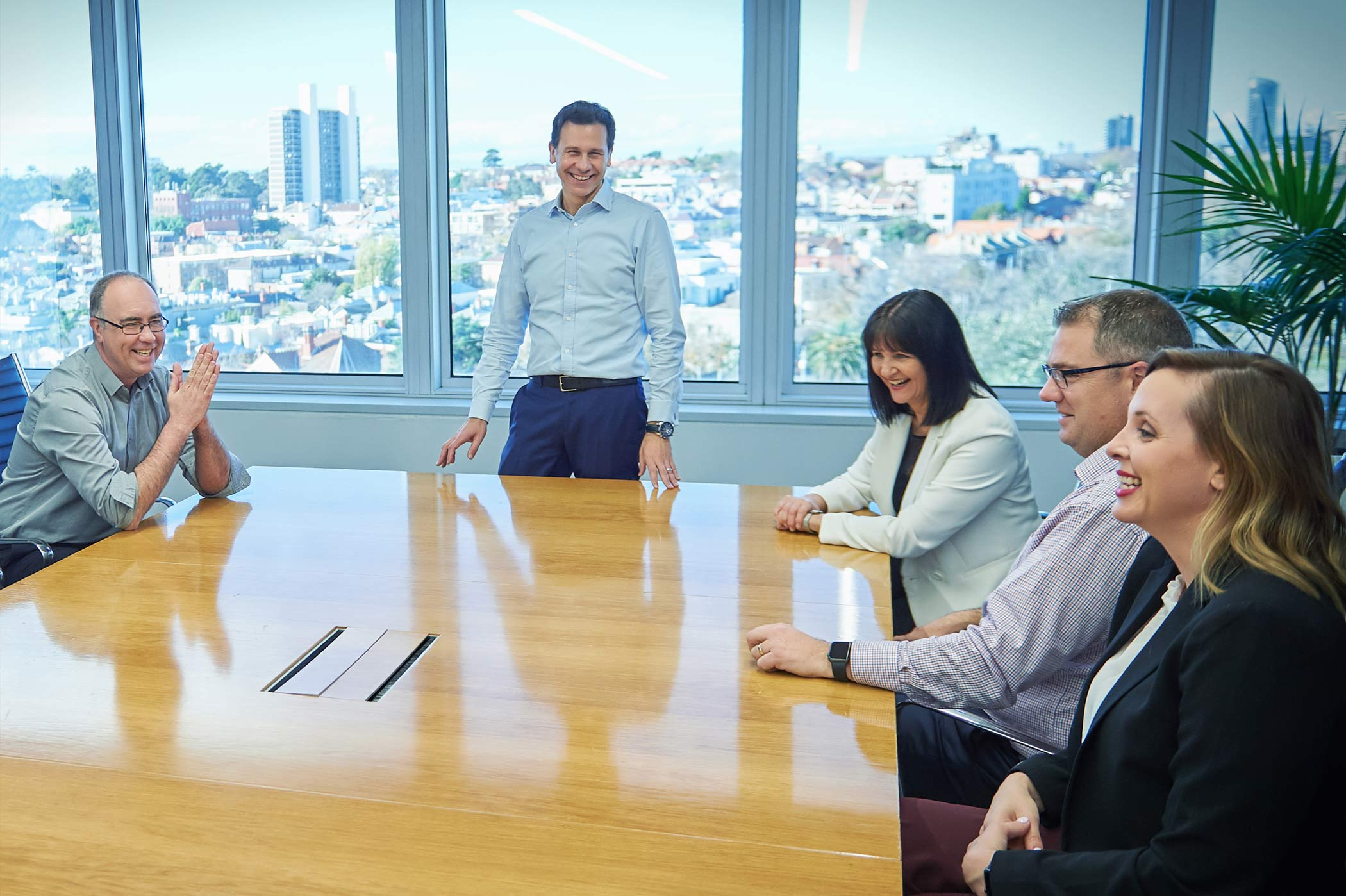 Leadership team in a boardroom meeting